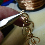 Then each link is inspected and joined with a jump ring.
